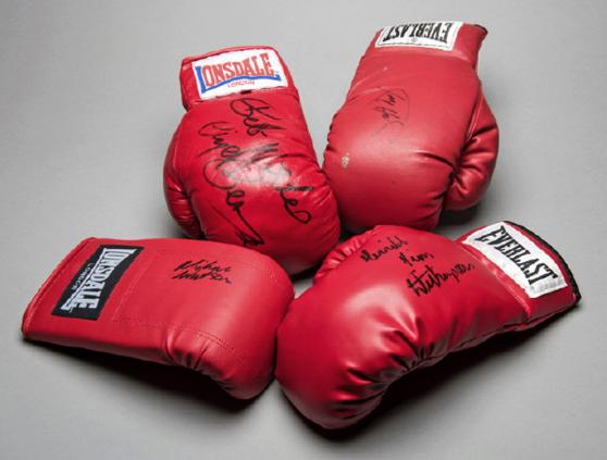 Four signed boxing gloves Larry Holmes Nigel Benn Michael Watson, Tim Witherspoon graham budd auctions sports memorabilia