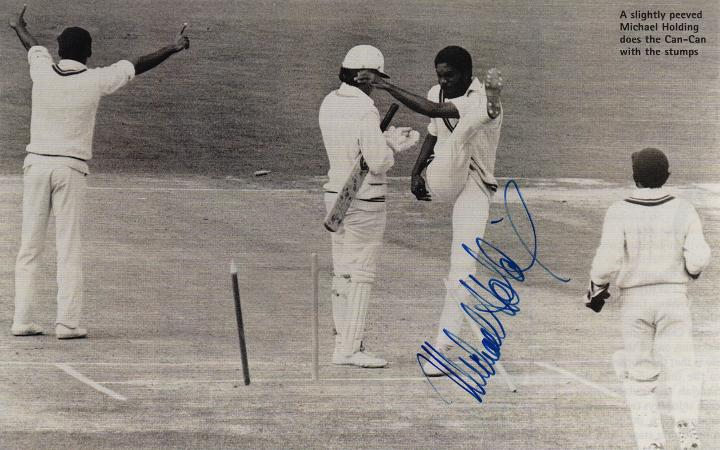 MICHAEL HOLDING autograph Signed west indies cricket memorabilia Jamaica magazine picture of him in action - doing the stump-kicking Can-Can - against England