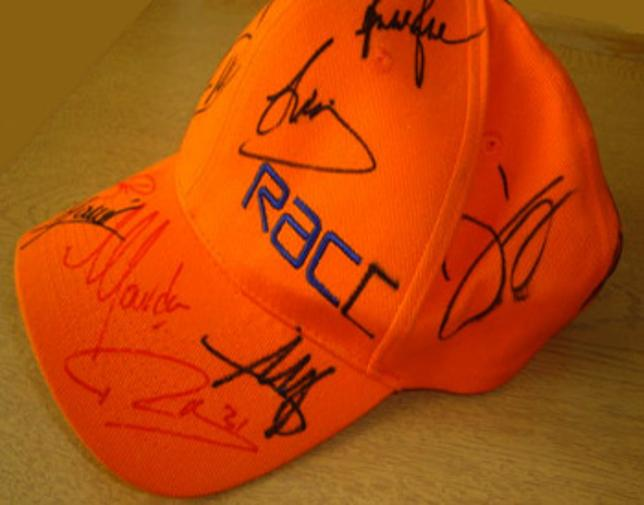 R.A.C. baseball cap signed by DAMON HILL, MARK BLUNDELL, JONATHAN PALMER, PAUL TRACEY, BOBBY RAHAL