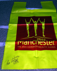 SIMON WHITFIELD memorabilia  (2000 Olympic & 2002 Commonwealth Triathlon champion) signed 2002 Commonwealth Games tabard swim cycle run triathlon memorabilia .