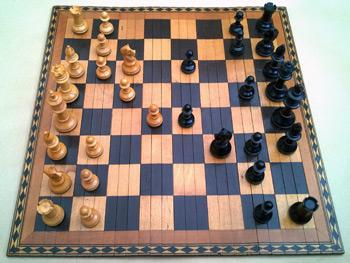Wooden-Folding-Roll-Up-Chess-Board-Staunton-Wood-Playing-Pieces-Boxed-Elevation-350